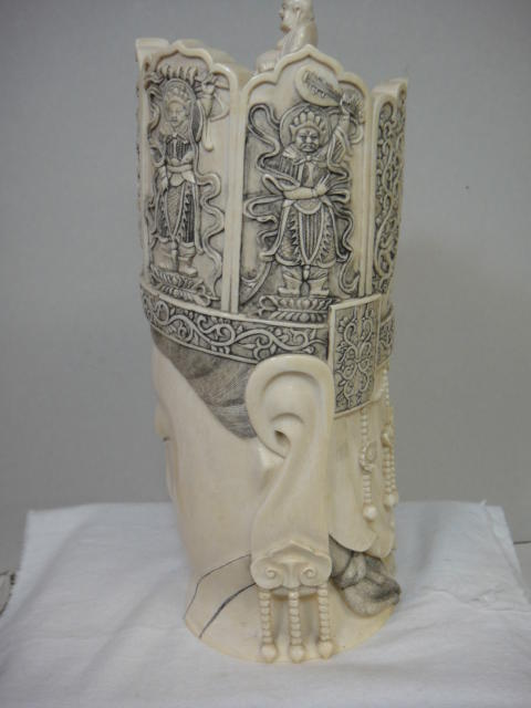 A carved ivory head of Guanyin 20th century