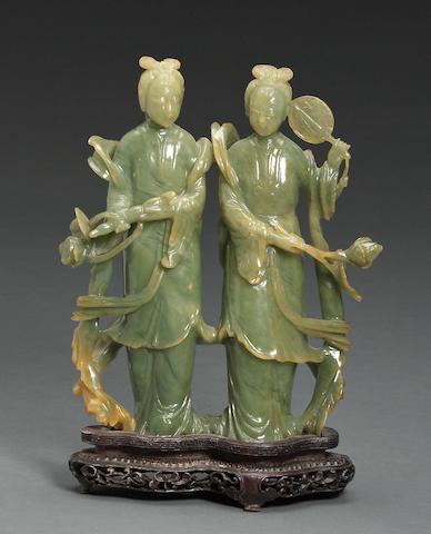 A carved jade group of two maidens