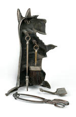 A hollow seated Scottie caddy with four piece fire side tool set