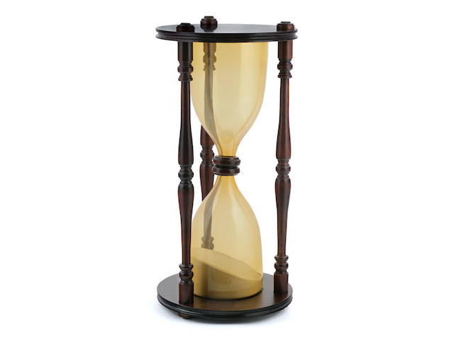 A large hour glass  23-1/2 x 11 in. (59.7 x 27.9 cm.)