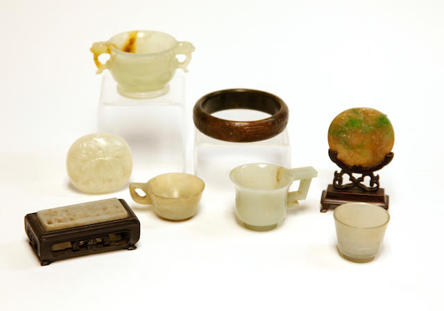 A group of eight jade and hardstone miniature decorations
