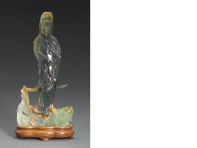 A carved hardstone figure of Guanyin on a carp 20th Century
