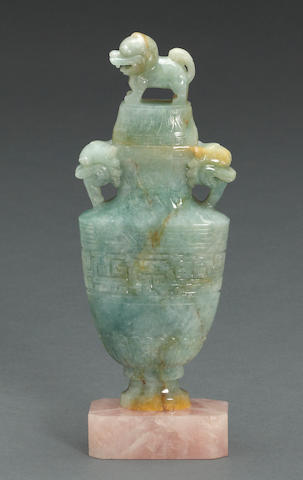 An archaistic jadeite covered vase