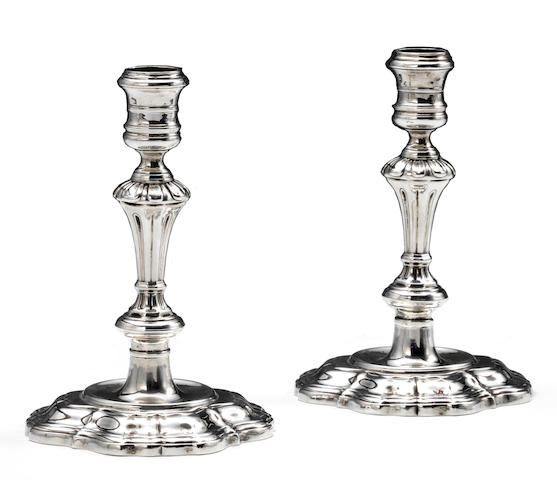 A pair of George II sterling silver cast inverted baluster form candlesticks<BR />Paul de Lamerie, London, 1735,
