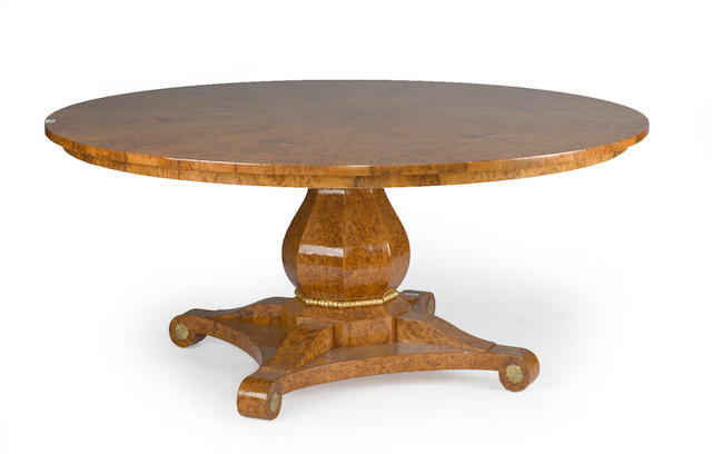 A 'Baluster' Charles X style burlwood circular dining table by Therien & Co.