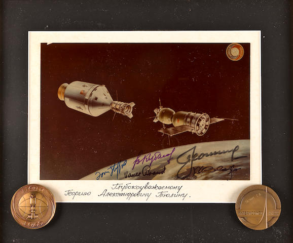 Color photograph signed by ASTP crew with 2 related medals