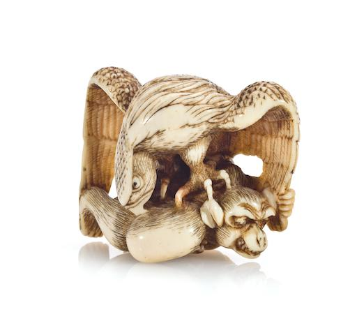 An ivory netsuke of an eagle attacking a monkey