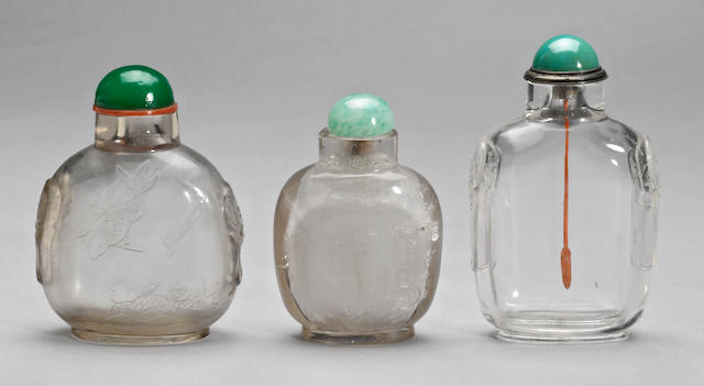Three snuff bottles, two of rock crystal and one of glass