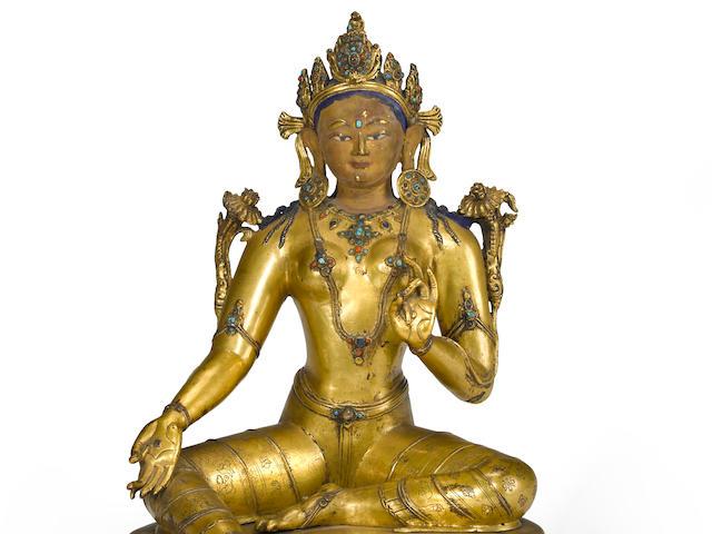 A gilt copper alloy figure Syamatara Tibet, 14th century
