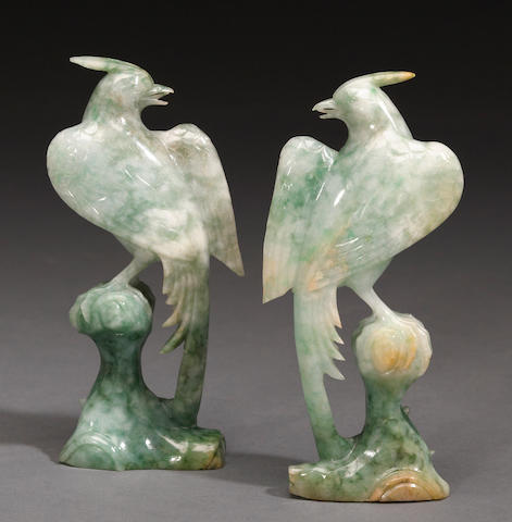 A pair of mottled green jadeite birds on rock