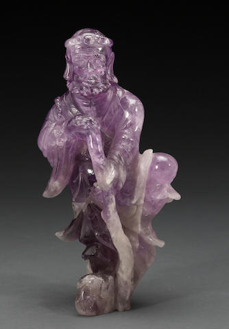 A Chinese carved amethyst figure of an immortal 20th century