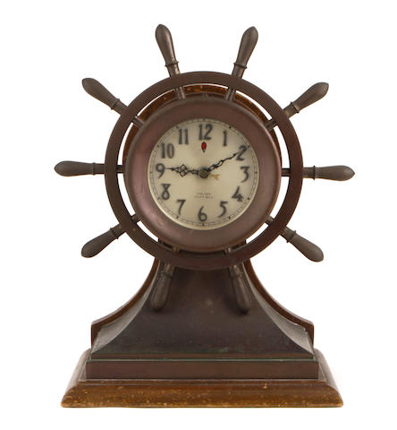 A Chelsea brass electric ship's bell mantel clock