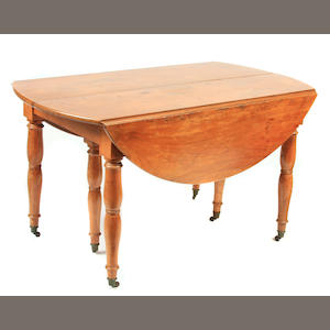A Louis XVI walnut turned leg dining table