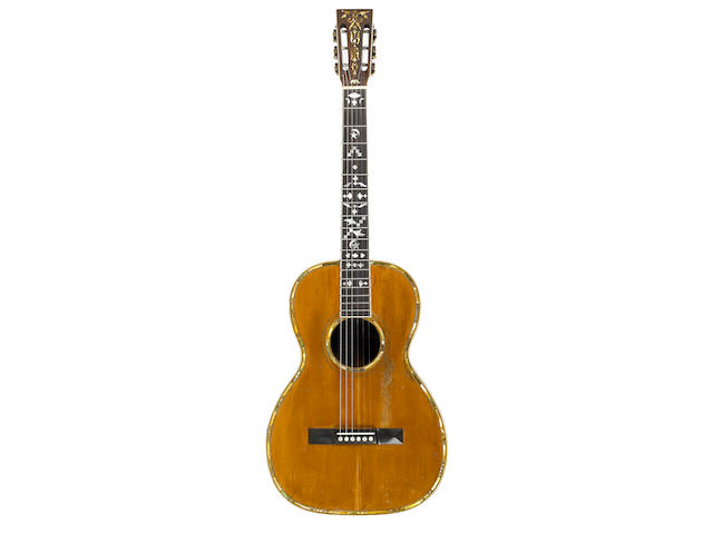 CARL SANDBURG'S GUITAR. Acoustic parlor guitar by Bauer, spruce and Brazilian rosewood, with abalone and other inlay to top, fingerboard, and head,