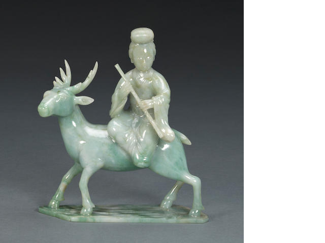 A jade carving of a beauty and deer