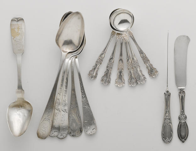A group of silver flatware