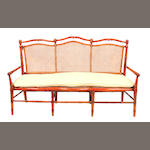 A French faux bamboo hardwood and caned settee
