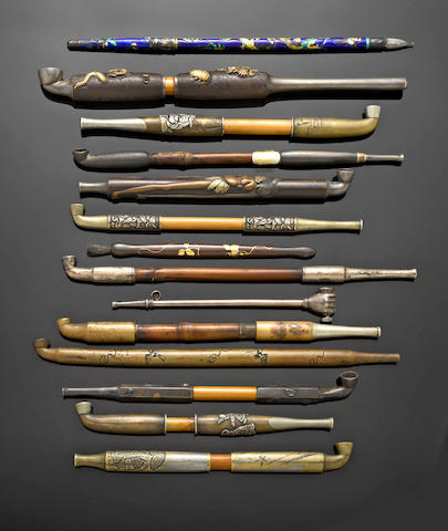 A group of Japanese pipes and writing implements