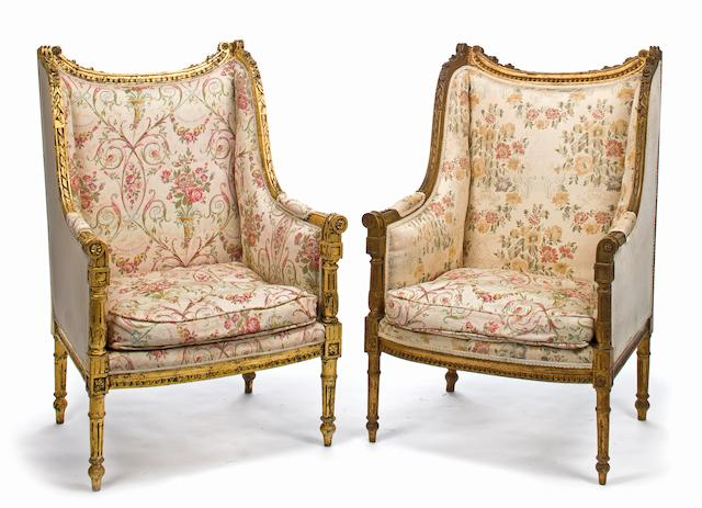 A pair of Louis XVI style carved giltwood bergères