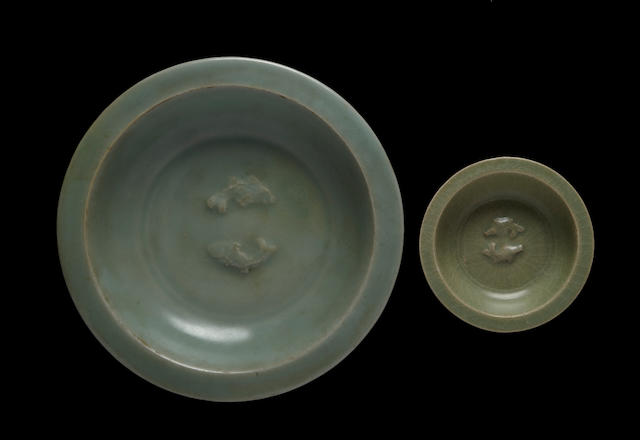 Two celadon glazed twin-fish dishes 13th/14th century