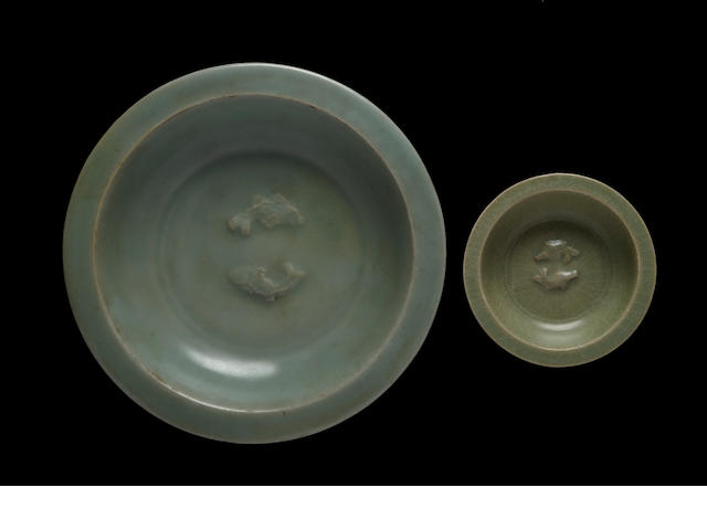 Two Chinese celadon glazed porcelain dishes with molded double fish decoration Song Dynasty