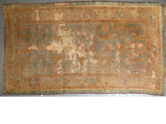 An Oushak rug size approximately 4ft. 11in. x 8ft. 9in.
