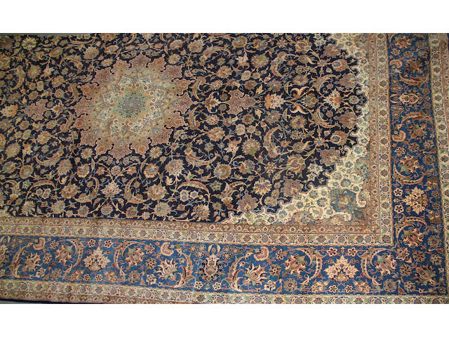 An Isphahan carpet size approximately 13ft. 6in. x 22ft. size approximately 13ft. 6in. x 22ft.
