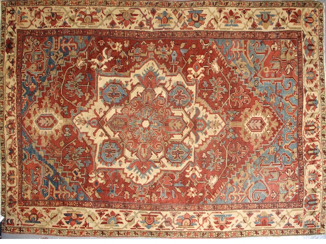 A Heriz carpet size approximately 9ft. x 12ft.