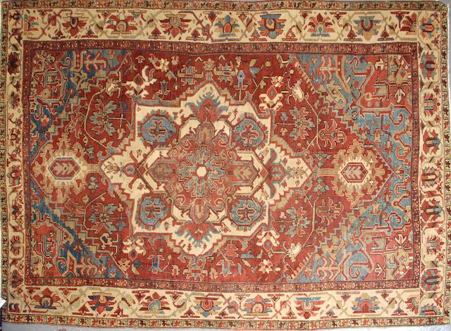 A Heriz carpet size approximately 9ft. x 12ft.