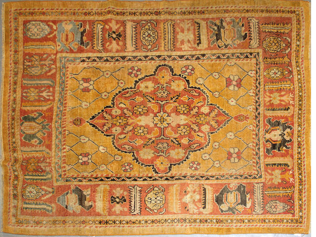An Oushak rug (rug has been cut and reduced) size approximately 7ft. x 8ft.