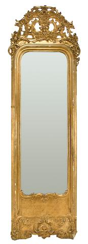 A Régence style carved giltwood and gilt composition pier mirror late 19th/early 20th century