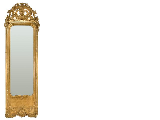 A Régence style carved giltwood and gilt composition pier mirror late 19th/early 20th century height approximately 9ft; width 32in