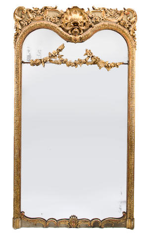 A large Baroque style giltwood and gilt composition mirror first quarter 20th century some losses to applied ornament height 83in; width 44 1/2in