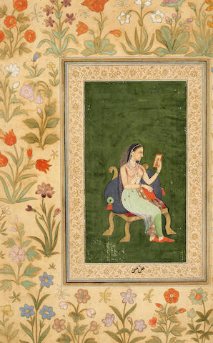 A princess viewing a painitng Mughal, circa 1630