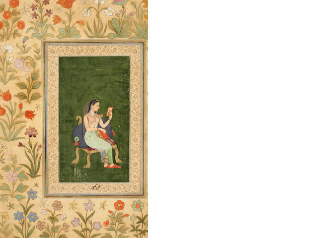 Lady looking at picture, Mughal