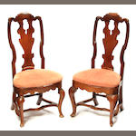 A pair of Continental Rococo carved walnut balloon seat side chairs