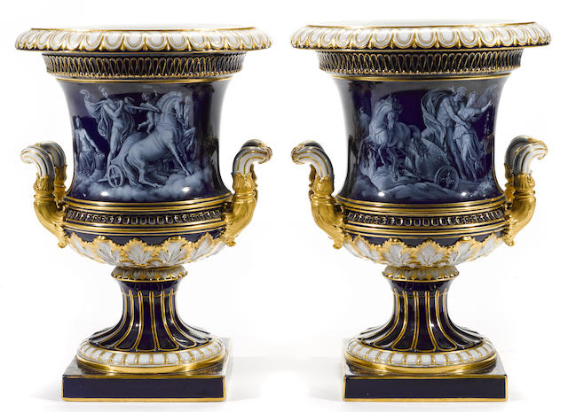 A pair of Meissen Limoges style enamel decorated porcelain urns<BR />late 19th century
