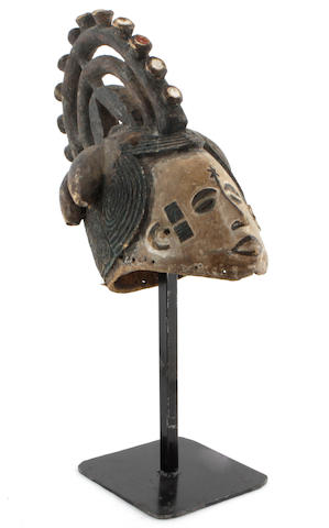 An Ibibio mask mounted on stand