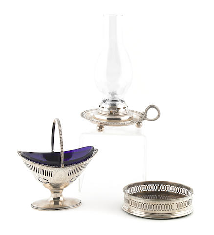 A George III silver sugar basket, thomas daniell, London , 1783, with cobalt glass liner; together with a silver and wood wine coaster, P?, London, 1777 (226), a George III silver chamberstick, Emes & Barnard, London, 1810 (367)