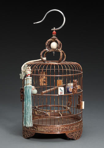 A carved wooden birdcage