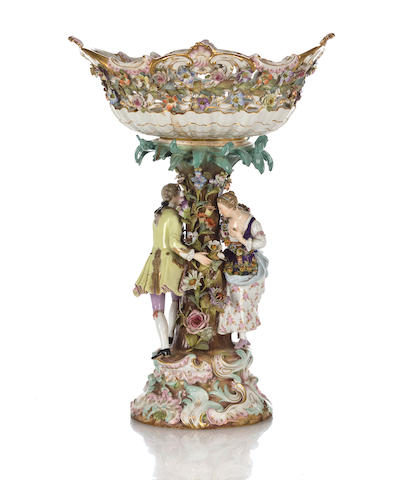 A Meissen porcelain figural centerpiece late 19th century some losses to flowers