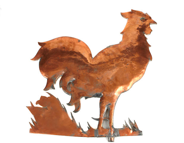 A polished copper rooster form weathervane