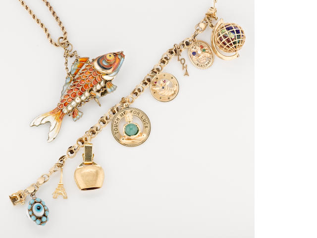a group of 1 7-charm charm bracelet in 14k gold, and 1 silver and enamel fish necklace with 14k gold chain