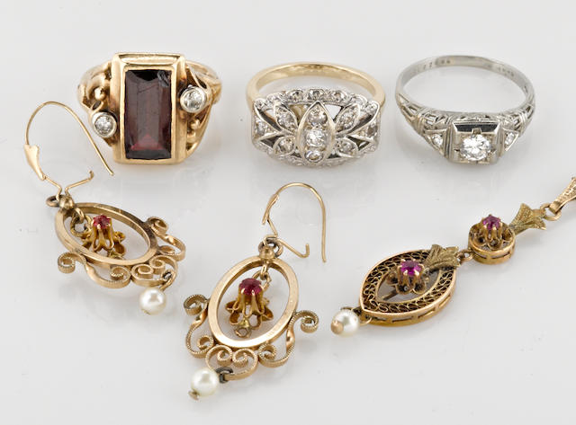 a collection of gem-set, diamond, platinum, 18k, 14k, and 10k gold, and gold-filled jewelry, including 3 rings and a necklace and earring set