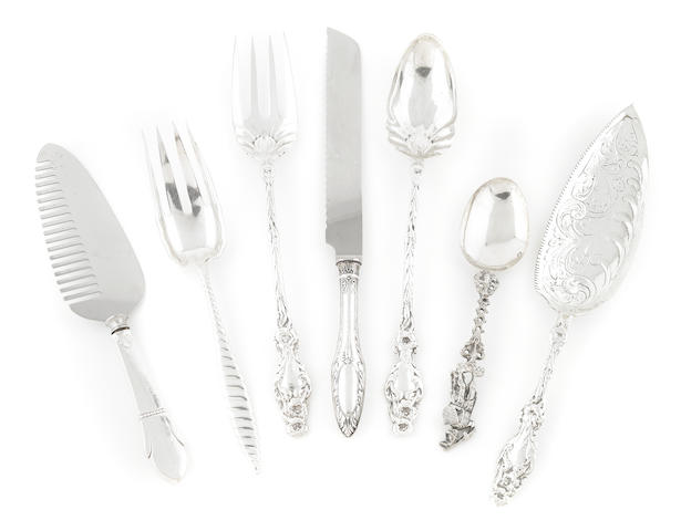 An assorted group of sterling silver serving flatware; together with two candle snuffers and a pen