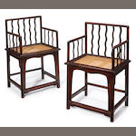 A pair of serpintine chairs