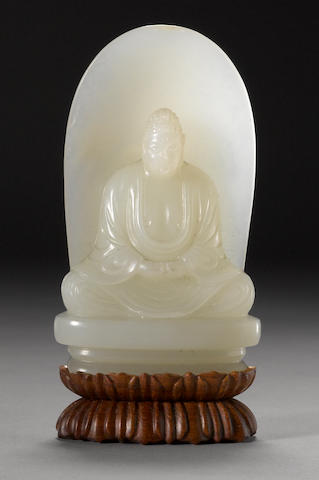 A small nephrite carving of a seated Buddha