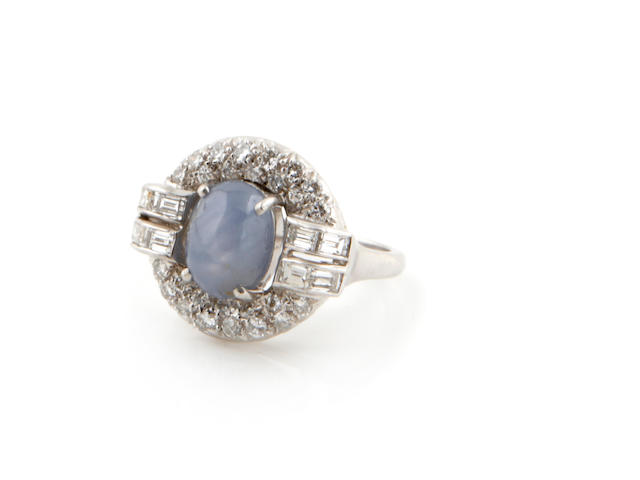 A sapphire cabochon and diamond ring