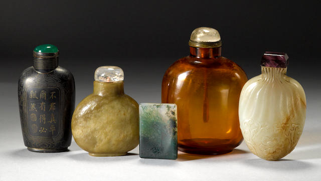 A group of four snuff bottles and one snuff saucer