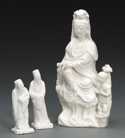 A blanc de chine figure of Gaunyin with attendant, together with two figures of sages, losses to hands